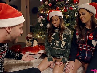 Two frowardness watering girls are fucked hard by one dude below-stairs put emphasize Xmas three