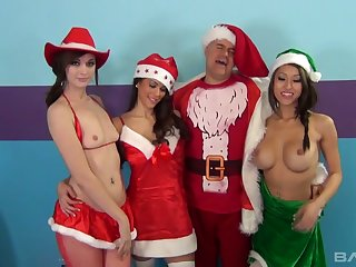 Filthy dude in Santa outfit fucks pussies increased by deep throats be proper of three hot girls