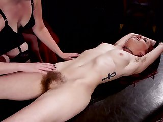 Immobilized whore gets her unshaved pussy teased by Aiden Starr