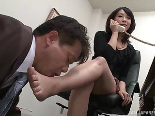 Kinky Japanese Nijikawa Sora on her knees pleasuring a stiff dick
