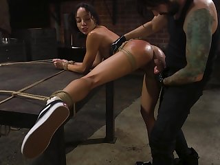 Suspended frowning model Alexis Tae whipped and fucked in be passed on BDSM room