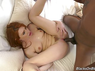 The big black dick suits this ginger's pussy just fine