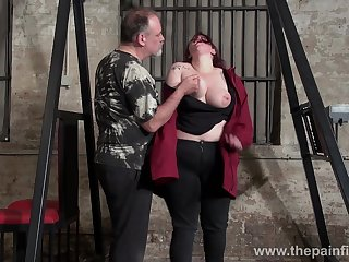Beamy in flames haired woman Emma gets punished in the BDSM room