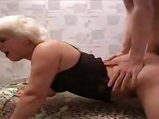 Blonde granny fucks in cowgirl and doggy style poses