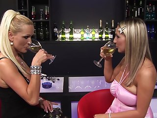 Sharon Pink and her girlfriends sharing a big cock in a bar