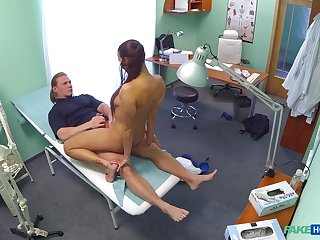 Mea Melone and a stud do the deed in a medical examination range
