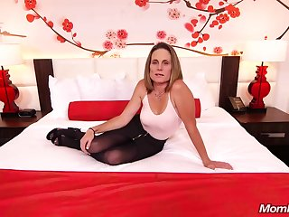 Skinny brunette milf with respect to saggy tits, Judith, is riding a hard white bushwa for a camera