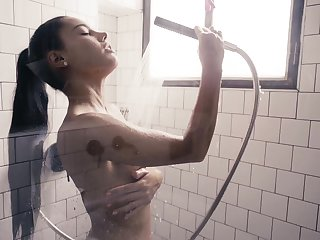 Fascinating beauty Apolonia is masturbating pussy in an obstacle shower