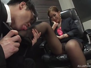 Kinky Asian chick teases a guy by jerking him off with the brush feet