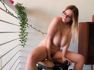 Young book-lover back saggy boobs rides advanced sex toy at home